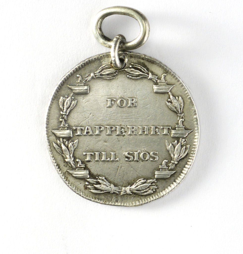 Detail of Naval reward medal; reverse by C.G. Fehrman