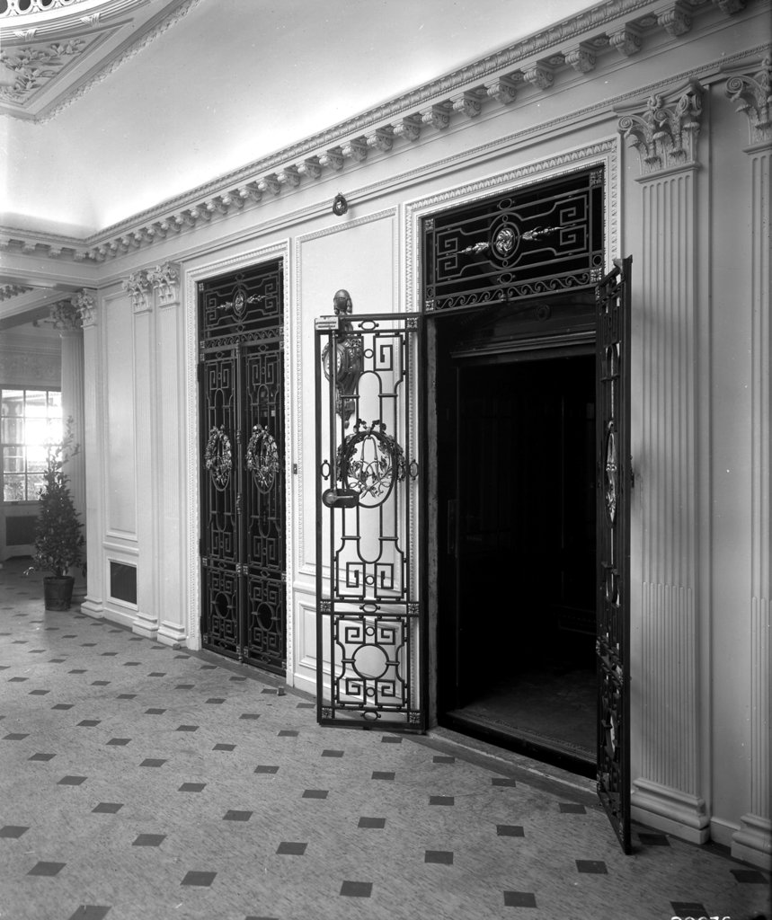 Detail of Passenger elevators in the Grand Entrance on the 'Aquitania' (1914) by Bedford Lemere & Co.
