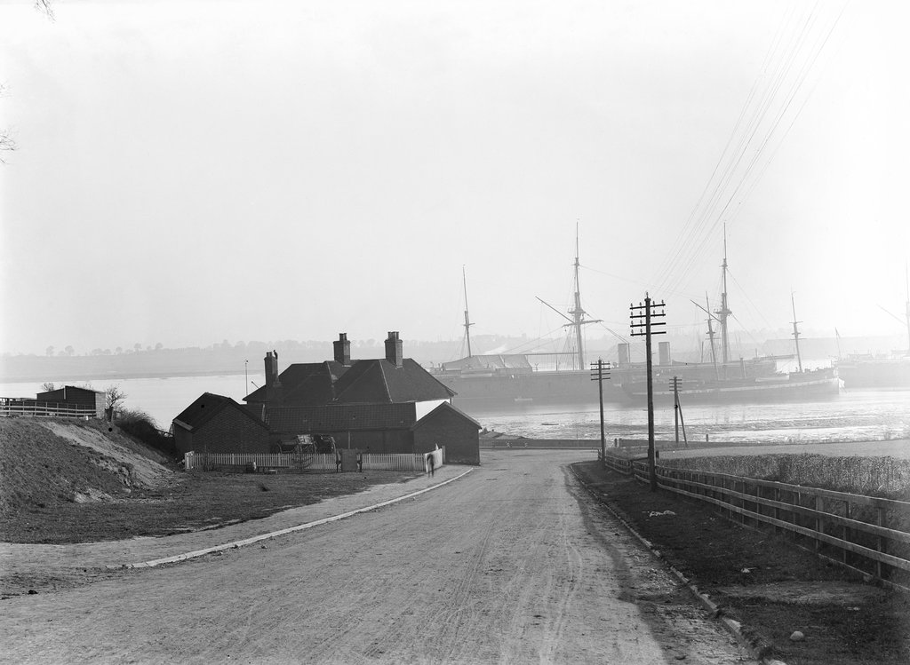 Detail of A view looking over the foreshore of Shotley Gate across the River Stour towards Harwich with the Bristol Arms on the left and the 'Ganges' training ships by Smiths Suitall Ltd.